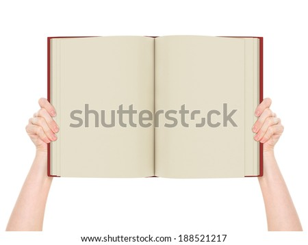 Hands holding book - stock photo