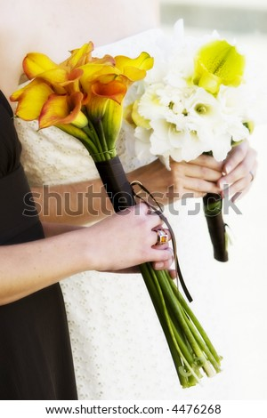 hands holding boquets of beautiful flowers - stock photo