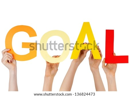 hands holding charakters which are building the word GOAL, isoated - stock photo