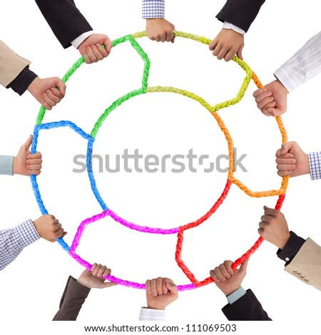 Hands holding colorful rope forming circle - stock photo
