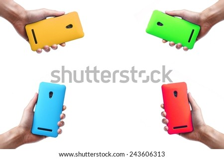hands holding colorful smartphones - stock photo