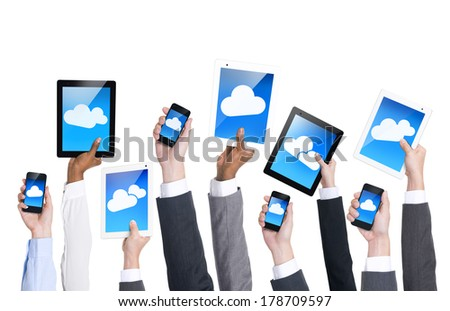 Hands Holding Digital Communication Devices - stock photo