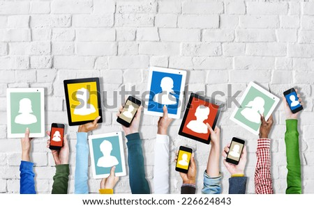 Hands Holding Digital Devices with Avatars - stock photo