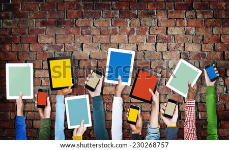 Hands Holding Digital Devices with Colorful Screens - stock photo