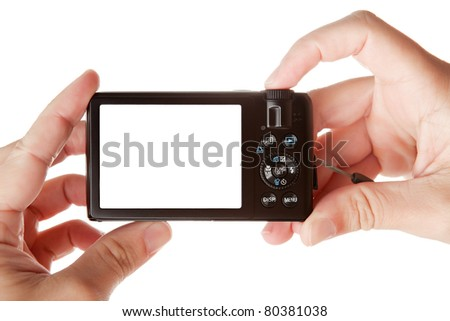 Hands holding digital photo camera with free space for your image, isolated on white background - stock photo