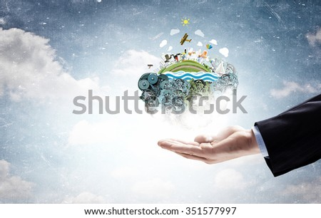 Hands holding Earth planet concept. Elements of this image are furnished by NASA - stock photo