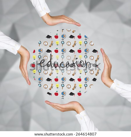 hands holding education icons on gray background - stock photo