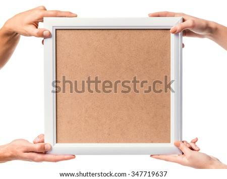 Hands holding frame close-up, isolated on a white background - stock photo