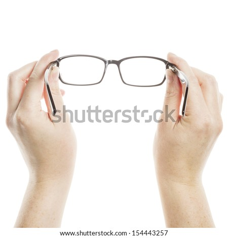 Hands holding glasses isolated on white background  - stock photo