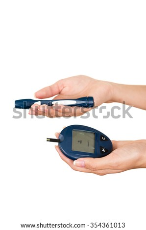 Hands holding glucose meter scanner pen and measure monitor in other hand with white background. - stock photo