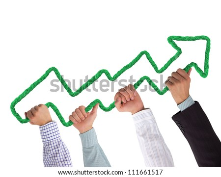 Hands holding green arrow pointing upwards - stock photo