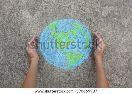 Hands holding planet Earth (drawing with chalk) - stock photo