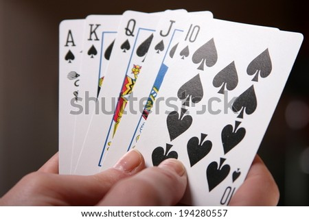 hands holding playing cards - stock photo