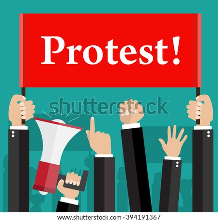 Hands holding protest signs and bullhorn - stock photo
