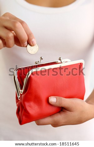 Hands holding red coin purse - stock photo