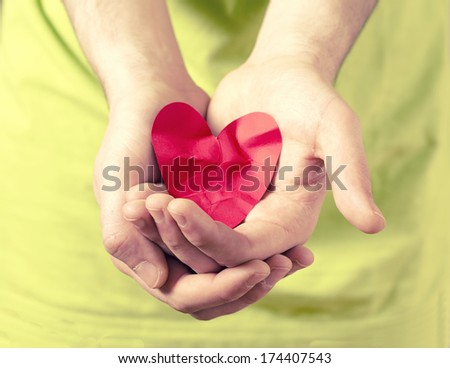 hands holding red heart. love concept - stock photo