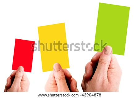 Hands holding red, yellow and green cards - stock photo