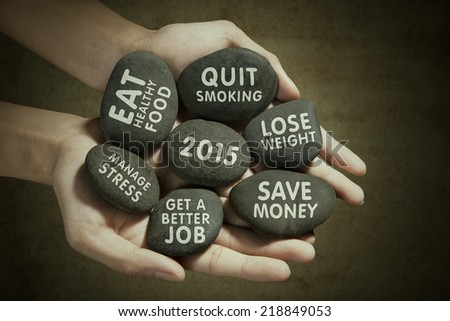 Hands holding stones with vision texts in the future 2015 - stock photo