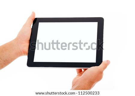 Hands holding tablet computer. Isolated on white background. - stock photo