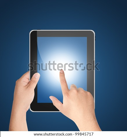 Hands holding tablet PC with blank blue screen isolated on blue background - stock photo