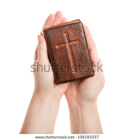 Hands holding the old bible isolated on white - stock photo