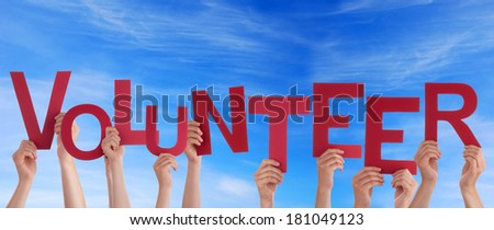 Hands Holding the Word Volunteer in the Sky - stock photo