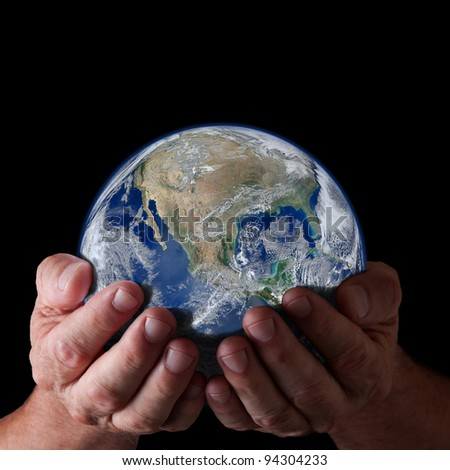 Hands holding world with isolated black background. Earth image courtesy of NASA. - stock photo