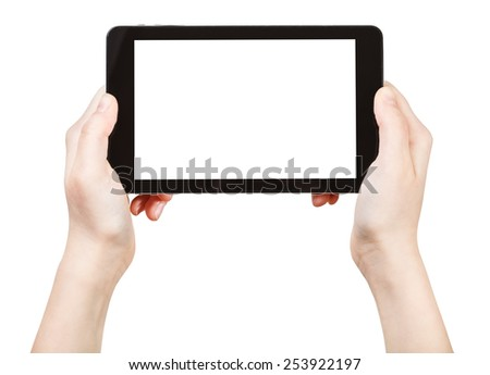hands holds tablet-pc with cut out screen isolated on white background - stock photo
