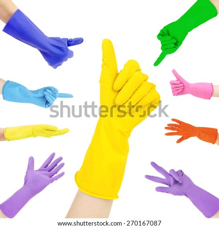 Hands in colorful gloves gesturing numbers isolated on white - stock photo