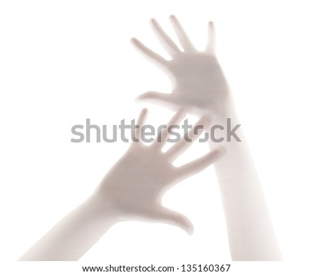 Hands in despair behind a transparent curtain - stock photo