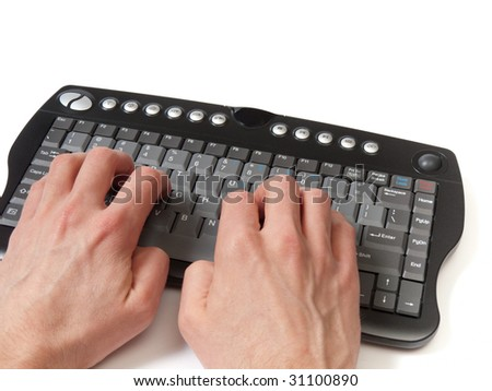 Hands in front of a compact black keyboard, on the home row, isolated on white. - stock photo
