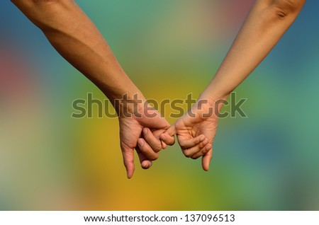 Hands in Hands with romantic together on colorful blue background - stock photo