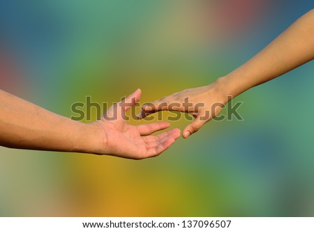 Hands in Hands with romantic together on colorful blue background, sign of hope, bright future - stock photo