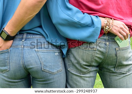 Hands in my Pocket (woman stealing from man's pocket) - stock photo