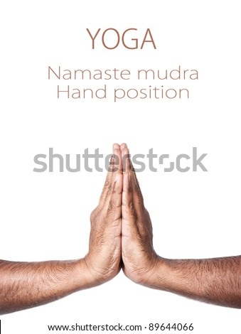 Hands in Namaste prayer mudra by Indian man isolated at white background. Free space for your text - stock photo