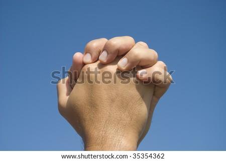 Hands in prayer gesture - stock photo