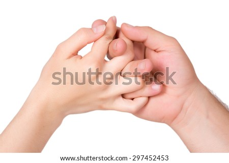 Hands - left hand is of a woman, right hand is of a man - stock photo