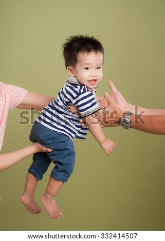Hands lift up little baby high, on green background, isolated - stock photo