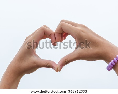 Hands make heart shape on sky background. Valentine - stock photo