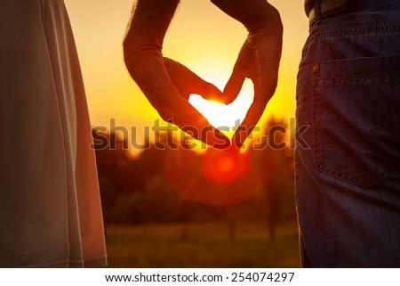 Hands making a heart shape - stock photo
