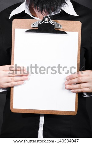 Hands of a business man conducting survey with empty clip board copy space - stock photo