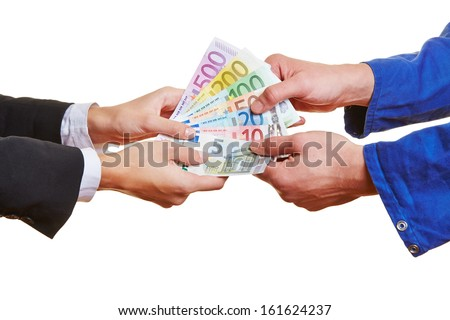 Hands of a construction worker and a business woman pulling on Euro money bills - stock photo