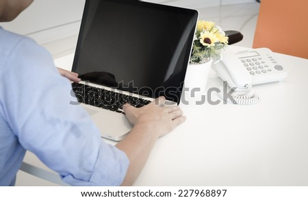 Hands of a man working with laptop - stock photo