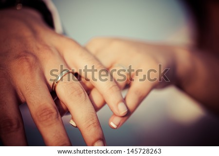 Hands of a newlywed couple - stock photo