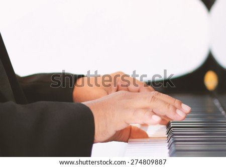 hands of a piano player,Close up shot - stock photo