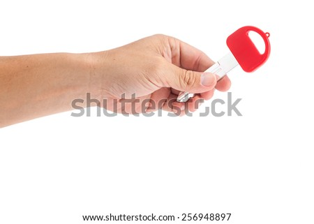 Hands of a picked up key In a manner delivery or extended. - stock photo