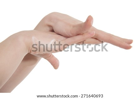 hands of a woman applying body lotion - stock photo