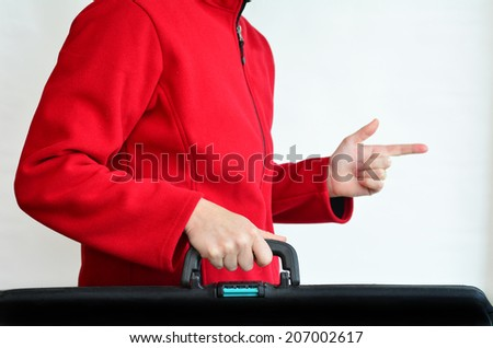 Hands of a woman carry travel suitcase against white background with copy space. Concept photo of travel, vacation, holiday, destination, tourism, traveler, tourist. - stock photo