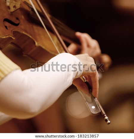 Hands of a woman playing the violin - stock photo