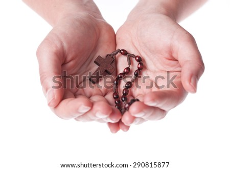 Hands of a woman Praying with Rosary, isolated on white - stock photo